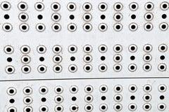 Metallic silver steel surface shiny weathered background with many round holes horizontal horizontal row royalty free stock photo