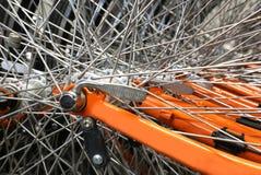 Metallic spokes of many bikes Royalty Free Stock Photo