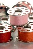 Metallic spools of thread stock photography