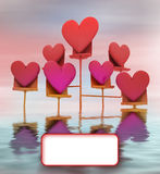 Metallic stand in water with pink red hearts card Royalty Free Stock Photo