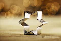 Metallic star baking shape on a table Stock Images
