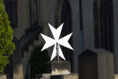Metallic star ion a grave at the Vysehrad Cemetery Royalty Free Stock Photo