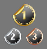 Metallic stickers. Gold silver and bronze metallic stickers  on grey background Stock Photos