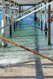 Metallic support system of pontoon. Under an old metallic bridge Stock Photo