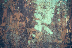 Metallic surface with peeled paint Stock Image