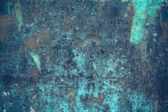Metallic surface with peeled paint Royalty Free Stock Photos