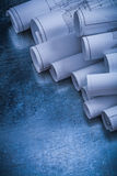 Metallic surface with variety of rolled up white Stock Photos