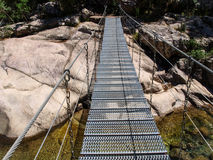 Metallic suspension bridge Royalty Free Stock Image