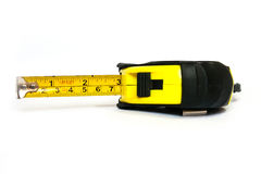Metallic tape measure. A device used for measuring the length of the object stock photography