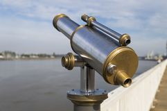 Metallic Telescope. The image shows a telescope at a panoramic point royalty free stock image