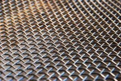 Metallic texture. Close up of a metallic net with and its typical texture Royalty Free Stock Photos