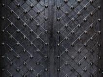 Metallic texture black elements of the old door stock photography