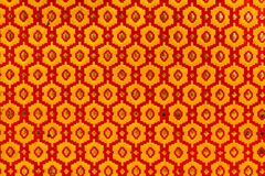Metallic texture of red and yellow hexagons. royalty free stock image