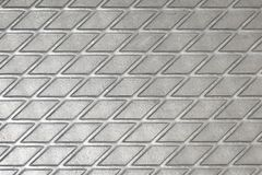 Metallic texture of a reelf shiny diamond color squares of lines intersecting. Metallic texture of a reelf shiny diamond color squares of lines intersecting stock image