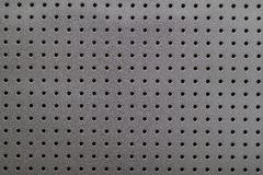 Metallic texture with holes background Stock Photos