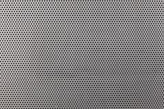 Close up on a metallic texture with small holes Royalty Free Stock Image