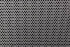 Close up on a metallic texture with small holes Royalty Free Stock Images
