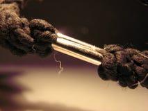 Metallic tie. Black elastic hair accessories with metallic tie Royalty Free Stock Image