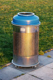 Metallic trash bin Stock Image