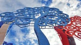 Metallic tree of life. Light blue red Royalty Free Stock Photo