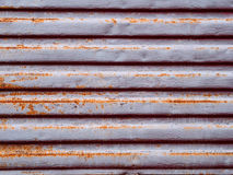 Metallic urban colored texture with rust. Horizontal pattern in the form of strips, blinds Stock Images