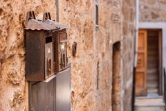 Metallic vintage mailbox on a brick wall. Orte, Italy royalty free stock photography
