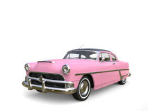 Metallic warm pink restored vintage car. Isolated on white background stock photo