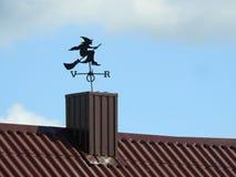 Metallic weathercock - witch over  smokestack Stock Photography