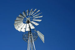 Metallic Windmill. With blue sky background Royalty Free Stock Image