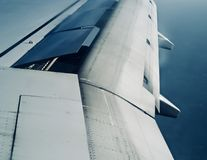 A metallic wings of an aircraft in the sky photograph. A large parts of an aircraft wings in the sky object unique stock photograph royalty free stock photography