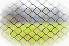 Metallic Wire Fence Stock Photo