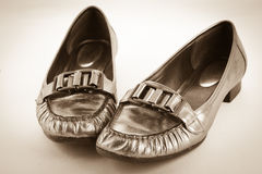 Metallic Womens Loafer Shoes Antiqued on White Royalty Free Stock Image