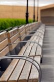 Metallic and wooden bench Royalty Free Stock Image