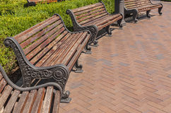 Metallic and wooden bench in a semicircle Royalty Free Stock Photography