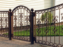 Metallic wrought gate stock photo