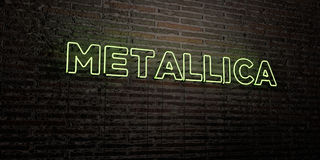 METALLICA -Realistic Neon Sign on Brick Wall background - 3D rendered royalty free stock image Royalty Free Stock Photos