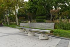 Metal bench in park Stock Photography