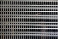 Metallisch rollen Sie oben Tür- und Gitterhintergrund lizenzfreies stockbild
