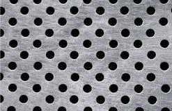 Metallische Platte mit voll der Löcher Lizenzfreie Stockfotos