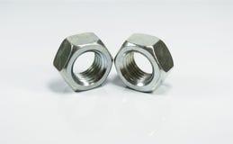 Metallische sechseckige Nüsse lizenzfreies stockbild