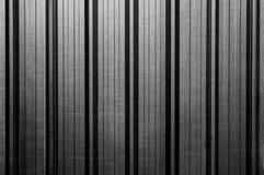 Metallischer gestreifter Wandhintergrund Stockfoto
