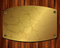 Metallischer Goldrahmen auf einem hölzernen Hintergrund 21 Stockfotografie