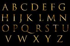 Metallisches Alphabet des Weinlesegusses gelbes Gold-beschriftet Worttext-Reihensymbol, auf schwarzem Hintergrund, Konzept zu unt lizenzfreie abbildung