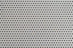 Metallisches Mustermakro des Laptop-Sprecher-Lochgitters mit Staub nach innen lizenzfreie stockfotos