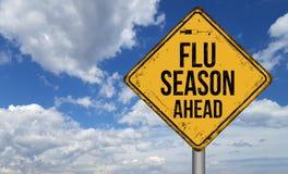 Metallisches Weinlesezeichen der Grippe-Saison voran Stockfotos