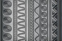 Metallisk bakgrund med modeller Arkivfoto