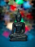 Metallisk buddha statuette på färgrik bakgrund royaltyfria foton