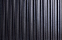 Metallisk randig svart texturbakgrund Arkivfoto