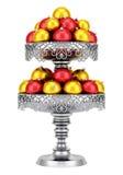 Metallisk vas med julbollar som isoleras på vit Royaltyfri Foto