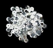 Metalliska paljetter för ljus silver på en svart bakgrund Royaltyfri Foto